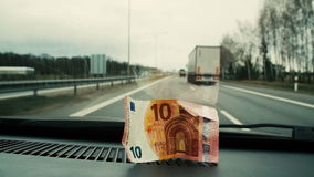 Ten euros placed in the car to the front glass. Close up stock video footage