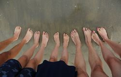 Ten feet of a family of five person on the beach. In summer royalty free stock photo