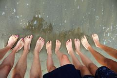 Ten feet of a family of five person. On the beach stock image