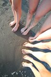 Ten feet of family with five persons. On the beach royalty free stock photos