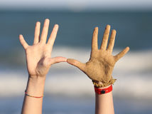 Ten fingers and two hands on the beach. Ten fingers and two hands of a child on the beach near the sea Royalty Free Stock Photo