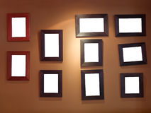 Ten frames on wall. Ten blank picture/photo frames on wall Stock Photo