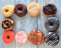 Ten frosted sprinkled dough nuts in frame Royalty Free Stock Photos