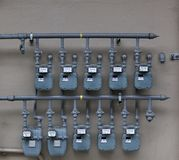 Ten Gas Meters. Ten Gray Gas Meters on the wall of an apartment building Stock Photography