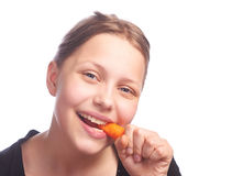 Ten girl eating carrot Royalty Free Stock Images