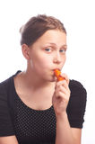 Ten girl eating carrot Royalty Free Stock Photography