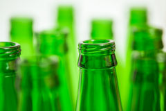 Ten green bottle necks on white background. Royalty Free Stock Images