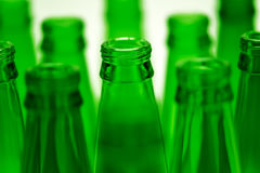 Ten green empty beer bottles shot. Stock Photo