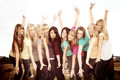 Ten happy girls. Ten smiling happy teenage girls outside with arms stretched Royalty Free Stock Photo