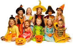 Ten kids in Halloween costumes together isolated