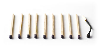 Ten matches, the last one is burnt out Royalty Free Stock Photo