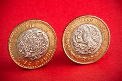 Free Ten Mexican Coin On Red Background. Shot Close Up Stock Photos - 137844013