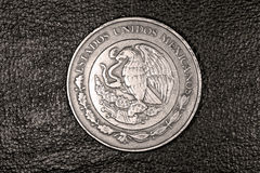 Ten mexican peso coin. On the leather surface Royalty Free Stock Image