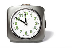 Ten minutes to twelve. A clock  on white Royalty Free Stock Image