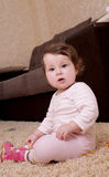 Ten months baby girl sitting and playing Royalty Free Stock Photo