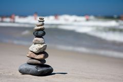 Ten pebbles stacked on beach Royalty Free Stock Images