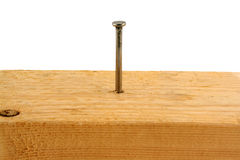 Ten penny nail in a peice of wood Stock Photo