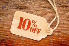 Ten percent off discount -  paper price tag. Ten percent off discount  - a paper price tag against rustic red painted barn wood Royalty Free Stock Image