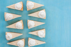 Ten pieces of cheesecake on a blue background, top view, like sweet, sweet tooth,. Sweets new york cheesecake slices top view Royalty Free Stock Image