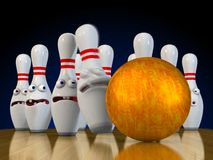 Ten pin bowling. Pins ready to be bowled over bracing for impact from the bowling ball Royalty Free Stock Image