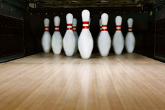 Ten pin bowling alley background. Closeup of tenpin row on a lane, night light Royalty Free Stock Photo