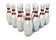 Ten Pin Bowling Pins. An arrangement of white and red used vintage bowling pins isolated on a white studio background Stock Photography