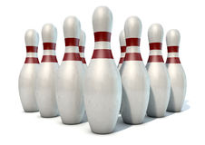 Ten Pin Bowling Pins. An arrangement of white and red used vintage bowling pins isolated on a white studio background Royalty Free Stock Photo