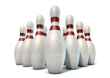 Ten Pin Bowling Pins. An arrangement of white and red used vintage bowling pins isolated on a white studio background Royalty Free Stock Photos