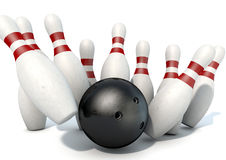 Ten Pin Bowling Pins And Ball. An arrangement of white and red used vintage bowling pins being struck by a bowling ball on an isolated white studio background Stock Images
