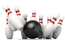 Ten Pin Bowling Pins And Ball. An arrangement of white and red used vintage bowling pins being struck by a bowling ball on an isolated white studio background Royalty Free Stock Photo