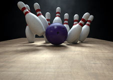 Ten Pin Bowling Pins And Ball. An arrangement of white and red used vintage bowling pins being struck by a bowling ball on a wooden bowling alley surface on a Stock Photography