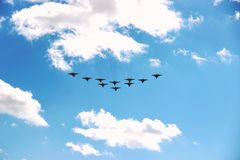 Ten planes in a blue sky with clouds on a Sunny day. stock image