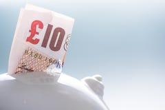 Ten pound British note in piggy bank Royalty Free Stock Photos