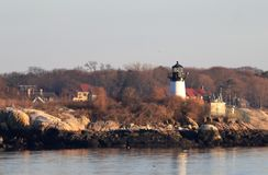 Ten Pound Island Lighthouse on Ten Pound Island, Gloucester, Massachusetts. At sunset stock images