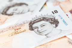 Ten pound notes lay on a table Royalty Free Stock Photo