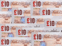 Ten pounds notes. Money background of ten pound banknotes Stock Images
