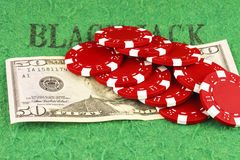 Ten red chips on a bill fifty dollars Stock Photo