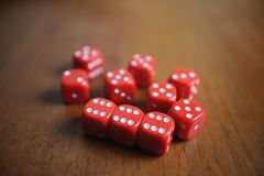Ten red dice on a table Royalty Free Stock Photos