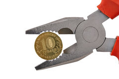 Ten Ruble Coin Held In Pliers Royalty Free Stock Photos