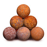 Ten rusty iron cannon balls on white background Royalty Free Stock Photography
