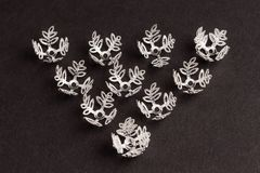 Silver leaf shaped beads for creating jewelry Stock Image