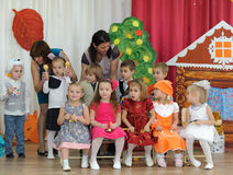 Ten small children and two adult women. BALASHIKHA, RUSSIA - OCTOBER 26: Ten small children, dressed in carnival costumes, and two adult women taking part in Royalty Free Stock Photo