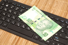 Ten South African Rand on computer keyboard Stock Image