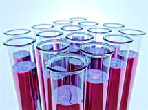 Ten test tubes with pink fluid and shallow DOF Royalty Free Stock Image