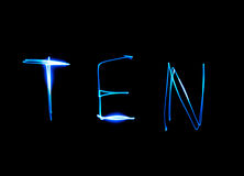 Ten - text. Painting light luminescent inscription word Royalty Free Stock Image