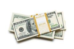 Ten thousand dollar stacks. On the white Stock Image