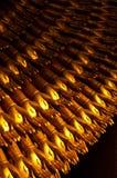 Ten thousand gold hands statue. Ten thousand golden hands statue ,black background royalty free stock photography