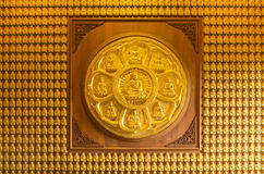 Ten thousand golden buddhas lined up along the wall Royalty Free Stock Images