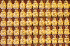 Ten Thousand Golden Buddhas lined up along The wall Royalty Free Stock Photo