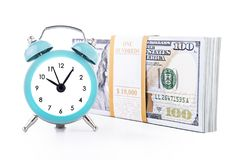 Ten thousand united states dollars currency banknotes bundle and. Green clock isolated on white background. Time is money financial successful business profits Stock Photography